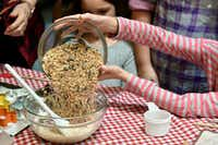 Megan Dempsey dumps birdseed into a bowl of gelatin, flour and water.(Ben Torres/Special Contributor)