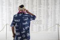 USS Arizona survivor Lou Conter salutes the Arizona Remembrance Wall in Hawaii.(<p></p><p>(Kent Nishimura/Getty Images)</p><p></p>)