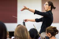 Chaowen Ting conducts the Dallas Opera Orchestra in rehearsal during the Linda and Mitch Hart Institute for Women Conductors program. (Smiley N. Pool/Staff Photographer)