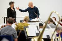 Italian maestro Carlo Montanaro works with Alexandra Cravero as she conducts the Dallas Opera Orchestra in rehearsal during the Linda and Mitch Hart Institute for Women Conductors program. (Smiley N. Pool/Staff Photographer)