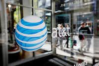 The AT&T-Time Warner merger will need to be approved by the Department of Justice and maybe the Federal Communications Commission. (File Photo/The Associated Press)