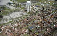 An aerial image of Rowlett from Dec. 27, 2015, shows the path of a tornado that ripped through the area on Christmas Eve. Nearly 450 buildings were destroyed by the deadly storm.(G.J. McCarthy)