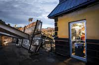 Employees worked in the kitchen of Buzzbrews diner in Dallas on June 27, mere feet away from the spot outside where a billboard was knocked over by storms, crushing a car in the parking lot of the adjacent Best Western Cityplace Inn.(Smiley N. Pool)