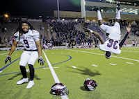 Rowlett defensive backs Daylon Bryant (9) and Elijah Baker (36) did backflips in celebration of their 63-62 win over Lakeview Centennial on Oct. 27 at Homer B. Johnson Stadium in Garland.(Ashley Landis)