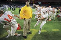 Celina running back Trace Young (right) narrowly avoided a collision with a security guard on the sidelines as he was forced out of bounds during the Class 4A Division II state championship football game at NRG Stadium in Houston on Dec. 18, 2015.(Smiley N. Pool)
