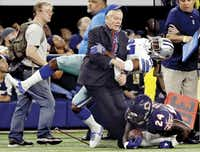 Dallas Cowboys safety J.J. Wilcox ran into a man on the sideline after tackling Chicago Bears running back Jordan Howard (24) during the first half of a game at AT&T Stadium in Arlington on Sept. 25. The Cowboys won 31-17.(Vernon Bryant)