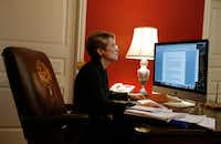 Laura Miller works on her computer in the home office she shares with her husband, former Texas legislator Steve Wolens. (David Woo/The Dallas Morning News)