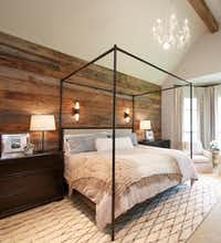 Emily Sheehan Hewett of A Well Dressed Home planked a master bedroom's walls with salvaged wood from an old barn in Arkansas. <p>(Nate Rehlander) </p><p></p>