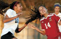 Southlake Carroll midfielder Neaka Khalilian (left) tugged on the hair of South Grand Prairie's Hillary Morales in the second half of a girls Class 6A first-round playoff game at Doskocil Stadium in Fort Worth on March 24. Southlake Carroll won 10-0.(Rose Baca)