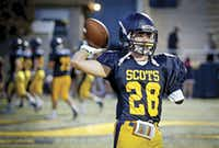 Cole Jackson warmed up before the Highland Park football game against West Mesquite on Oct. 6 in Highland Park. Jackson, a running back on the junior varsity team, lost most of his left arm two years ago after an accident on an all-terrain vehicle.(G.J. McCarthy)