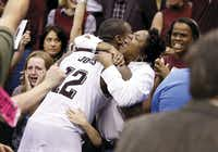 Texas A&M guard Jalen Jones hugged his mother, Yolanda Jones, after the Aggies defeated Northern Iowa in the second round of the NCAA men'€™s basketball tournament in Oklahoma City on March 20. The Aggies rallied from 12 points down with 44 seconds remaining in regulation to defeat the Panthers 92-88 in double overtime.(Vernon Bryant)