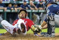 Texas Rangers third baseman Adrian Beltre was tagged out at home by Seattle Mariners catcher Steve Clevenger during the third inning of a game on June 3 at Globe Life Park in Arlington.(Ashley Landis)