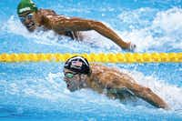 Michael Phelps led Chad Guy Bertrand Le Clos of South Africa as the American closed in on the gold medal in the men's 200-meter butterfly final at the Rio Games on Aug. 9. It was Phelps'€™ 20th gold medal, and by the time the Games were over, he would claim three more.(Smiley N. Pool)