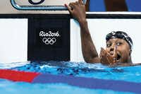 U.S. swimmer Simone Manuel reacted after winning the gold medal in the women's 100-meter freestyle at the 2016 Olympic Games on Aug. 11 in Rio de Janeiro. Manuel, of Sugar Land, Texas, became the first African-American woman to win an individual event in Olympic swimming. She and Penny Oleksiak, of Canada, tied for a win in the event with a new Olympic record time.(Smiley N. Pool)