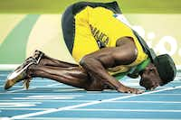Usain Bolt of Jamaica kissed the track after winning gold in the men's 4x100-meter relay at the 2016 Olympic Games in Rio de Janeiro on Aug. 20. The sprinter said it was his final Olympic race.(Smiley N. Pool)
