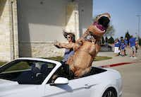 Rebecca Rapattoni (left), the sister of American Idol top four finalist Dalton Rapattoni, and dinosaur-clad friend Rhonda Fullerrode in a parade honoring Rebecca's brother during the singer'€™s visit to Sunnyvale on March 26. Dalton Rapattoni finished third on the show, behind Idol runner-up La'Porsha Renae and champion Trent Harmon.(Andy Jacobsohn)