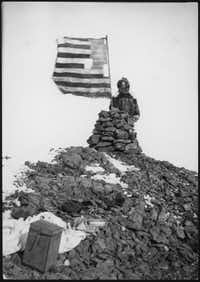 The great explorer Robert Peary at his cairn atop Cape Thomas Hubbard, 1906.  Peary reported that he had seen an Arctic continent that was dubbed Crocker Land, which turned out to be an illusion.  From <i>A Wretched and Precarious Situation</i>, by David Welky. (Credit: National Archives and Records Administration)