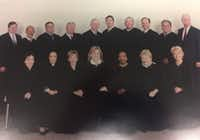 Dallas County's felony court judges circa 2005. Faith Johnson is on the front row, third from the right. Former District Attorney Susan Hawk, who resigned three months ago, is in the front row, first from the right. John Creuzot, who says he is running as a Democrat for district attorney in 2018, is on the back row, second from the left. Manny Alvarez, who recalls that Johnson was often the first to arrive at work at the last to leave, is on the back row, second from right. (Courtesy photo)