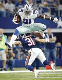Dallas Cowboys rookie running back Ezekiel Elliott leaped over Chicago Bears safety Chris Prosinski on a run play at AT&T Stadium in Arlington on Sept. 25.(Vernon Bryant)