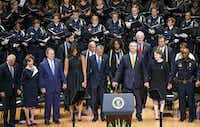 President Barack Obama joined hands with Dallas Mayor Mike Rawlings as they and other dignitaries attended an interfaith memorial service for the fallen officers at the Morton H. Meyerson Symphony Center in Dallas on July 12.(Smiley N. Pool)