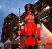 Large nutcrackers adorn the shops along the Texas Christkindl Market outside Globe Life Park in Arlington.((Tom Fox/The Dallas Morning News))