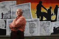 In this 2011 file photo, La Bajada resident and WWII Navy vet poses in front of a mural to veterans at the Bataan Community Center. The mural is now gone. (Ben Torres/Special Contributor to The Dallas Morning News)