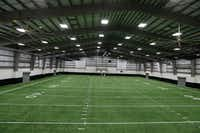The new Indoor practice facilities interior at Arlington High School in Arlington. (Nathan Hunsinger/The Dallas Morning News)