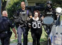 The Dallas police SWAT team took a woman into custody after a six-hour standoff in the 2100 block of Estacado Street near Casa View Elementary School in East Dallas on Aug. 31.(David Woo)