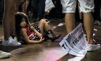 Alexandria Martin, 4, of Richardson waited for Republican presidential candidate Donald Trump to speak to supporters during a campaign rally June 16 at Gilley's Dallas.(Ashley Landis)