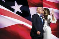 Presumptive GOP nominee Donald J. Trump got a kiss from his wife Melania after she addressed the second session of the Republican National Convention on July 18, in Cleveland. Social media lit up with comparisons of her address and a 2008 speech by Michelle Obama.(Smiley N. Pool)