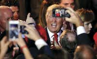President-elect Donald Trump shook hands with supporters after making his acceptance speech at an election party at the Midtown Hilton in New York City in the early-morning hours of Nov. 9.(Tom Fox)