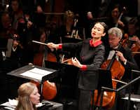 Tianyi Lu conducts during the Institute For Women Conductors event at the Winspear Opera House in Dallas, TX, on Dec. 10, 2016. (Jason Janik/Special Contributor)(Special Contributor)
