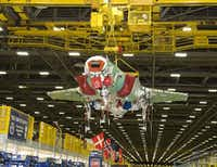 An F-35 fighter jet is moved on the assembly line at the Lockheed Martin facility in Fort Worth. President-elect Donald Trump criticized the program in a tweet Monday. (Tom Harvey/Lockheed Martin)