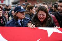 Relatives of Turkish police Officer Erdem Ozcelik who was killed in bomb attacks outside Vodafone Stadium in Besiktas on Saturday, mourned over his coffin Monday in Istanbul. (Getty Images)