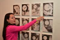 Taiwanese-Malaysian artist Poesy Liang describes her artwork which was on display at Thompson Fine Arts Inc. in Dallas.(Sam Hsu)