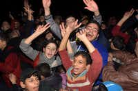 Syrians celebrate on December 12, 2016 in the government-held Mogambo neighbourhood of the northern Syrian city of Aleppo, after rebel fighters retreated into a small pocket of their former bastion in the face of new army advances.(AFP/Getty Images)