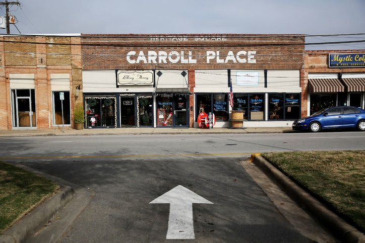 A View Of Carroll Place In The Square Downtown Mesquite Surrounded By Historic Brick Buildings Curly Has Up Its Holiday Decor