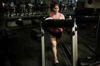 "Allison Cavazos runs on the treadmill during the ""Cross Tread"" class at Tread Fitness in Dallas. ((Andy Jacobsohn/Staff Photographer))"