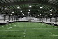 The new Indoor practice facilities interior at Arlington High School.Nathan Hungsinger/Staff Photographer