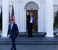 President-elect Donald Trump waves goodbye to Mitt Romney after they met on Nov. 19. (Aude Guerrucci/Bloomberg)