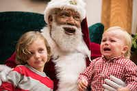 Santa Larry Jefferson smiles with Auden Good, 4, and his one-year-old brother Ezra of Ramsey during photos at the Santa Experience at Mall of America on Dec. 1, 2016 in Bloomington, Minn. (Leila Navidi/Minneapolis Star Tribune/TNS)