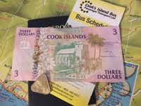 A colorful three-dollar bill and a triangular two-dollar coin are both legal tender in the Cook Islands. New Zealand dollars can also be used in the tiny country.(JAY JONES)