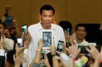 Philippine President Rodrigo Duterte, arrives a meeting with the Filipino community, in Phnom Penh, Cambodia, Tuesday, Dec. 13, 2016. (AP Photo/Heng Sinith)(AP)