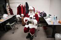 Santa Larry Jefferson got ready in his dressing room at the Santa Experience at Mall of America on Dec. 1 in Bloomington, Minn.((Leila Navidi/Minneapolis Star Tribune))