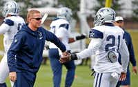 Dallas Cowboys running back Ezekiel Elliott (21) and head coach Jason Garrett touch hands during practice at Ford Center at The Star in Frisco, Texas, Wednesday, Dec. 7, 2016. (Jae S. Lee/The Dallas Morning News)(Staff Photographer)