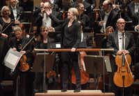"Conductor Ruth Reinhardt turns the audience after the third movement of Lutoslawski's ""Concerto for Orchestra"" at the Morton H. Meyerson Symphony Center on Thursday, Nov. 17, 2016. (Rex C. Curry/Special Contributor)(Special Contributor)"