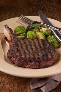 The Cowboy Steak, a bone-in ribeye, is a signature at Perini Ranch Steakhouse.((Ralph Lauer/Zuma Press))