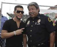 In 2010, Tito El Bambino and Sgt. Gil Cerda at the 11th Annual Latin Grammy Street Party in Oak Cliff. (Al Dia archive photo). The