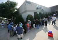 NTTA customers wait in line to pay their tolls at the agency's Plano headquarters. (File Photo/Vernon Bryant)