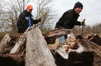 Mark Morris (right) and Clint Jenkins look beneath a pile of wood in northern Collin County during a weekly search for clues to the whereabouts of Mark's daughter, Christina.((Rose Baca/Staff Photographer))